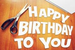 Lycklig födelsedag för text till dig paper rester Arkivfoton