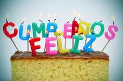 lycklig födelsedag som skrivs i spanjor Royaltyfria Bilder