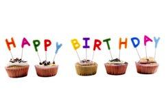 Lycklig födelsedagmuffin med stearinljus Arkivbild