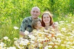 Lycklig familj av tre Royaltyfria Bilder