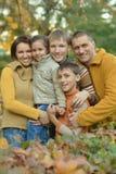 Lycklig familj i höstskog Royaltyfria Bilder