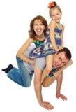 Lycklig familj i studio Arkivfoto