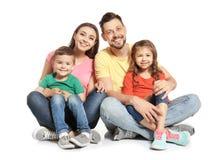 Lycklig familj med gulliga barn på vit bakgrund royaltyfri fotografi