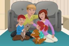 Lycklig familj med husdjur Arkivfoton
