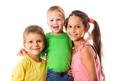 Lycklig familj med tre ungar Fotografering för Bildbyråer