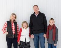 Lycklig familj på jul Fotografering för Bildbyråer