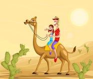 Lycklig familj på kamelritt Royaltyfri Bild