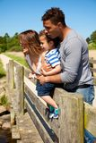 Lycklig familj som har gyckel på deras semester Royaltyfria Foton