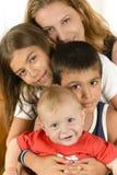 Lycklig familj som tycker om samhörighetskänsla royaltyfri fotografi
