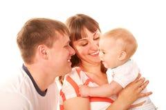 Lycklig familj tillsammans. Fotografering för Bildbyråer