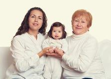 Lycklig familjstående - farmor, dotter och sondotter Royaltyfria Bilder