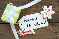 Lycklig ferieetikett för röd och grön jul arkivfoto