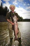 lycklig fiskare fotografering för bildbyråer