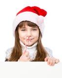 lycklig flicka i den santa hatten med stående behin för julgodisrotting arkivfoton