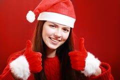 Lycklig flicka i den santa torkduken Arkivfoton