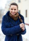 Lycklig flicka i lag i vinter Fotografering för Bildbyråer