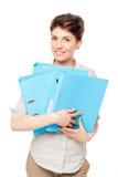 Lycklig flicka med blåa mappar för dokument på en vit Royaltyfria Bilder