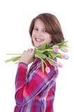 Lycklig flicka med en grupp av tulpan Fotografering för Bildbyråer