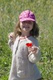 Lycklig flicka med en lilja Arkivbild