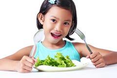 Flicka med grönsaken Royaltyfri Bild