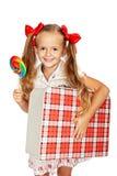 Lycklig flicka med klubban Arkivbild