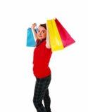 Lycklig flicka med shoppingpåsen Arkivbild