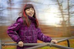 Lycklig flicka på karusell royaltyfria bilder