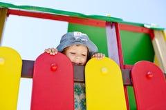Lycklig flicka på lekplatsen Arkivbild