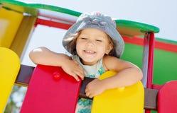 Lycklig flicka på lekplatsen Arkivfoton