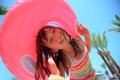 Lycklig flicka på semester Arkivfoto