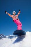 Lycklig flicka på snowboard Royaltyfri Bild