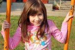 Lycklig flicka på swing Royaltyfria Foton