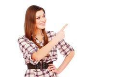 lycklig flicka peka något Arkivfoto