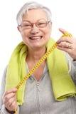 Lycklig gammal lady med måttband Arkivbilder