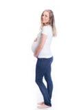 Lycklig gravid kvinna på vit bakgrund Arkivbild