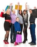 Lycklig grupp av shoppingfolk Royaltyfri Bild