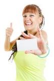 Lycklig gullig le kvinna- eller tonåringflicka som visar tomt mellanrumsPA Royaltyfri Foto