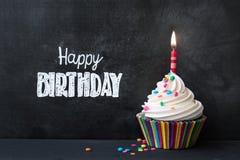 lycklig hälsning för födelsedagkortmuffin arkivbild