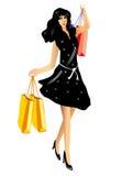 Lycklig härlig kvinna med shoppingpåsar Arkivfoto
