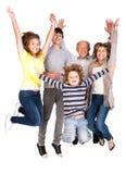 lycklig hög banhoppning för familj Royaltyfri Foto