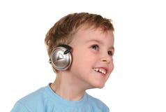 lycklig hörlurar för pojke Arkivbilder