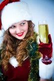 lycklig hatt santa för champagneclaus flicka Arkivbild