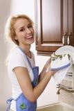 lycklig hemmafru Arkivfoton