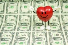 Lycklig hjärta på många $2 räkningar Fotografering för Bildbyråer