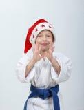 Lycklig idrottskvinna i locket Santa Claus Royaltyfria Foton