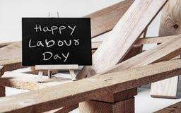 Lycklig internationell arbetar`-dag och lyckligt begrepp för arbets- dag Sm Royaltyfri Foto