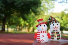Lycklig jul med snoman två Royaltyfria Bilder