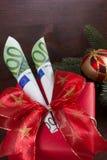 Lycklig jul med tvåhundra euro Arkivbilder