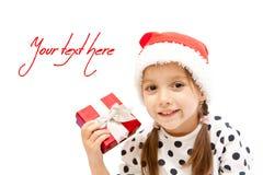 lycklig julflicka little present Fotografering för Bildbyråer