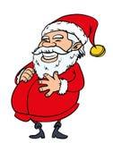 Lycklig jultomten med en stor buk Royaltyfria Foton